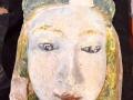 La tête de la statue de la vierge en cours de nettoyage